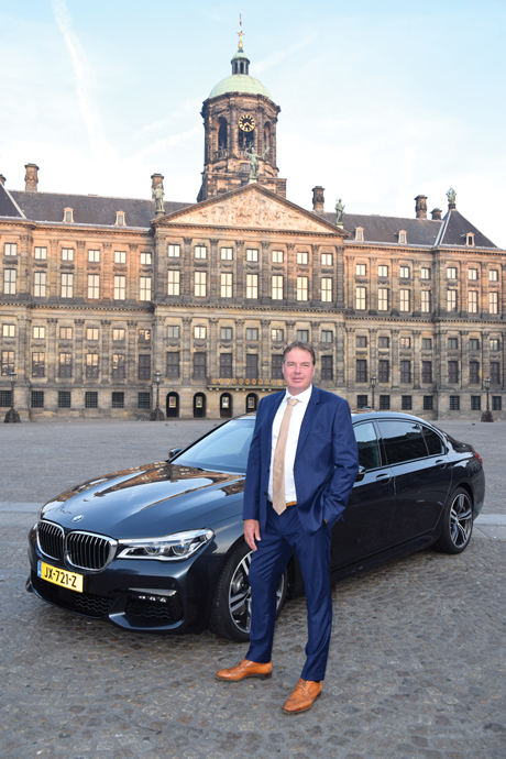 Bart van Leijden and one of ETS's BMWs in front of The Royal Palace of Amsterdam